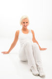 Fitness woman resting on white floor Royalty Free Stock Photo
