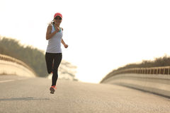 fitness woman runner athlete running at road Royalty Free Stock Photos