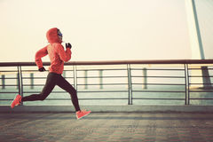 Fitness woman runner athlete running at seaside road Stock Photo