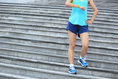 Fitness woman runner looking at her sports watch Stock Image