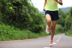 Fitness woman runner running outdoor Stock Photos
