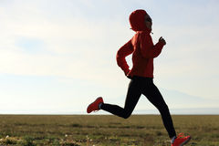 Fitness woman runner running on road Royalty Free Stock Photography