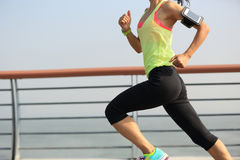 Fitness woman runner running at seaside Royalty Free Stock Images