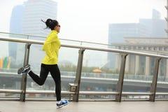 Fitness woman runner running at shanghai city Stock Image
