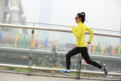Fitness woman runner running at shanghai city Stock Images