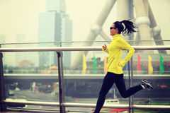 Fitness woman runner running at shanghai city Royalty Free Stock Photo