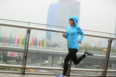 Fitness woman runner running at shanghai city Royalty Free Stock Image