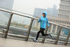 Fitness woman runner running at shanghai city Stock Photo