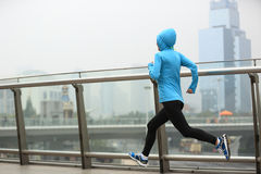 Fitness woman runner running at shanghai city Stock Photography