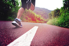 Fitness woman runner running on trail Stock Photo