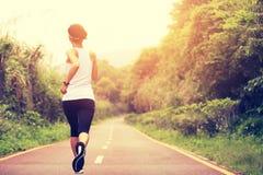 Fitness woman runner running Stock Image