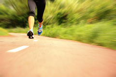 Fitness woman runner running on trail Royalty Free Stock Photography