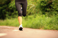 Fitness woman runner running on trail Stock Images