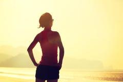 Fitness woman runner on sunrise seaside Royalty Free Stock Photos