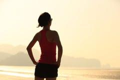 Fitness woman runner on sunrise seaside Royalty Free Stock Images