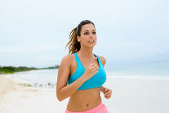 Fitness woman running at the beach Royalty Free Stock Images