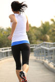 Fitness woman running at city footbridge Royalty Free Stock Images
