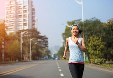 Fitness woman running at city street Royalty Free Stock Photos