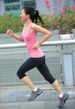 Fitness woman running at city Stock Photos