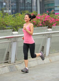 Fitness woman running at city Stock Photography