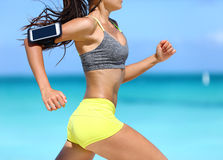 Fitness woman running fast wearing phone armband Stock Photography