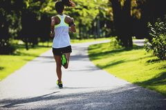 Fitness woman running on highway road royalty free stock photography