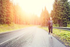Fitness woman running at the morning in mountains. Stock Photography