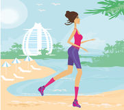 Fitness Woman Running by the Ocean Royalty Free Stock Photos
