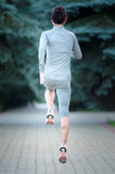 Fitness Woman Running outdoors. Back view Royalty Free Stock Photos