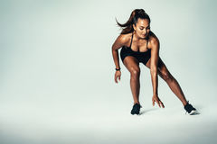 Fitness woman running over grey background stock photography