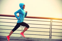 Fitness woman running at seaside Royalty Free Stock Image
