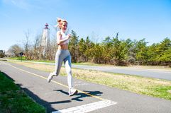 Fitness woman running on the street. stock images