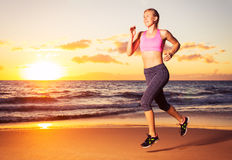 Fitness woman running at sunset Royalty Free Stock Photos