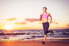 Fitness woman running at sunset Stock Image