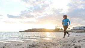 Fitness Woman Running at sunset stock video footage