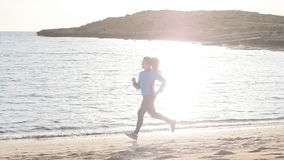Fitness Woman Running at sunset stock video