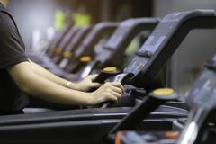 Fitness woman running on treadmill and burn fat in the body in t royalty free stock photography