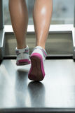 Fitness Woman Running On Treadmill Stock Images