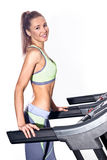 Fitness woman running on treadmill in gym Royalty Free Stock Image