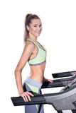 Fitness woman running on treadmill in gym Royalty Free Stock Photos