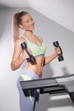 Fitness woman running on treadmill in gym Stock Photo