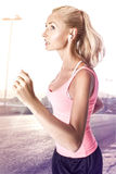 Fitness woman running. Royalty Free Stock Images