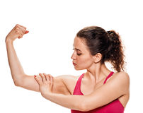 Fitness woman showiing biceps muscles Royalty Free Stock Photo