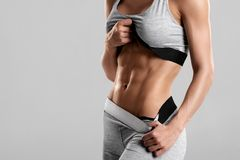 Fitness woman showing abs and flat belly, . Athletic girl shaped abdominal stock photo