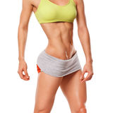 Fitness woman showing abs and flat belly. Sexy muscular woman Royalty Free Stock Image