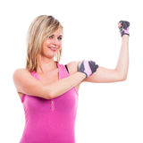 Fitness woman showing biceps Royalty Free Stock Image