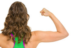 Fitness woman showing biceps . rear view Stock Photo
