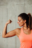 Fitness woman showing biceps Stock Photography
