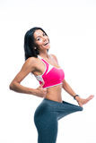 Fitness woman showing big pants Stock Photos