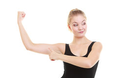 Fitness woman showing energy flexing biceps Royalty Free Stock Images